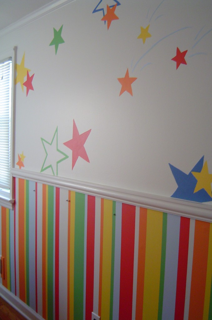 Children's bedroom painted with bright multi-colored stripes and stars