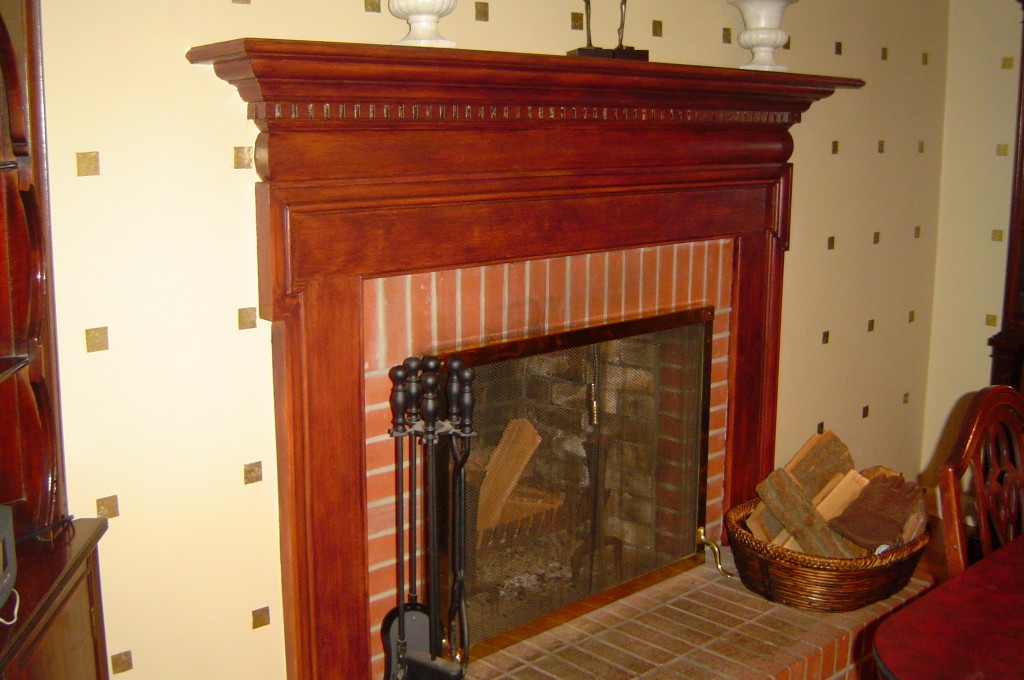 Fireplace surround painted to replicate red mahoghany