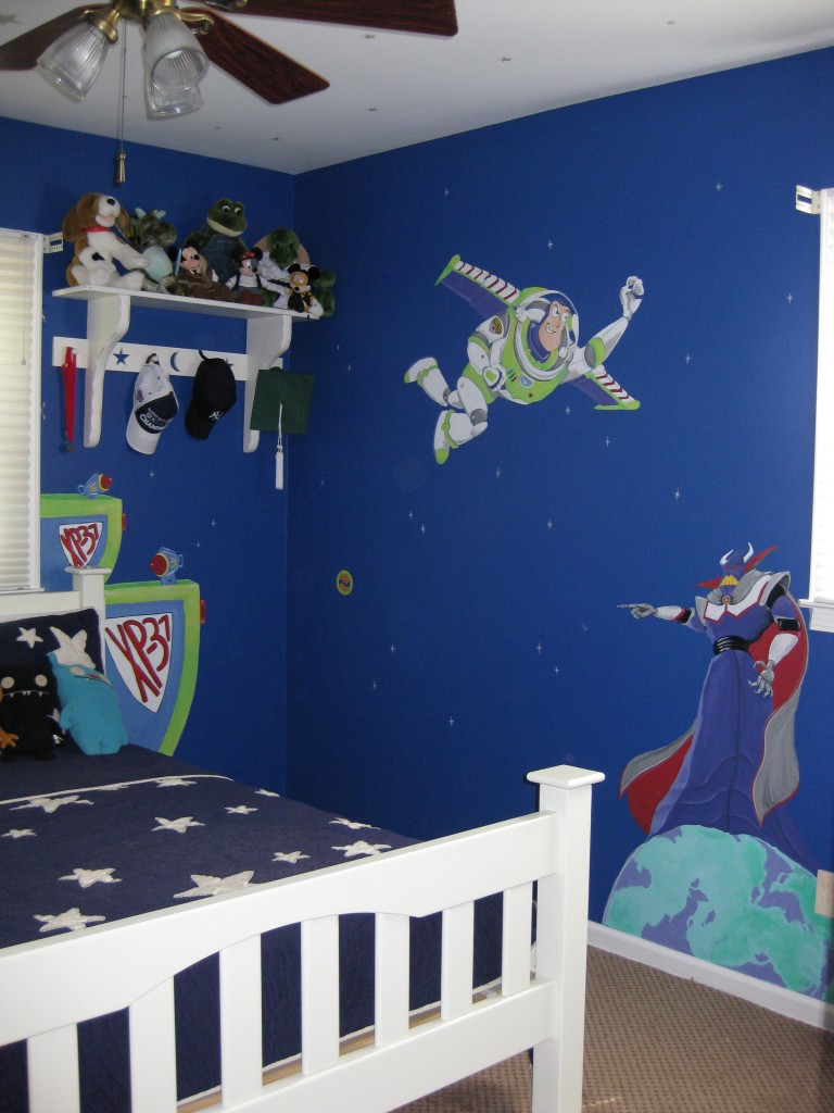 """""""Space Ranger Spin"""" themed mural painted in boy's bedroom."""