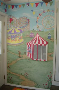 Amusement park themed mural painted in playroom, incorporating wall-mounted heating unit in design.