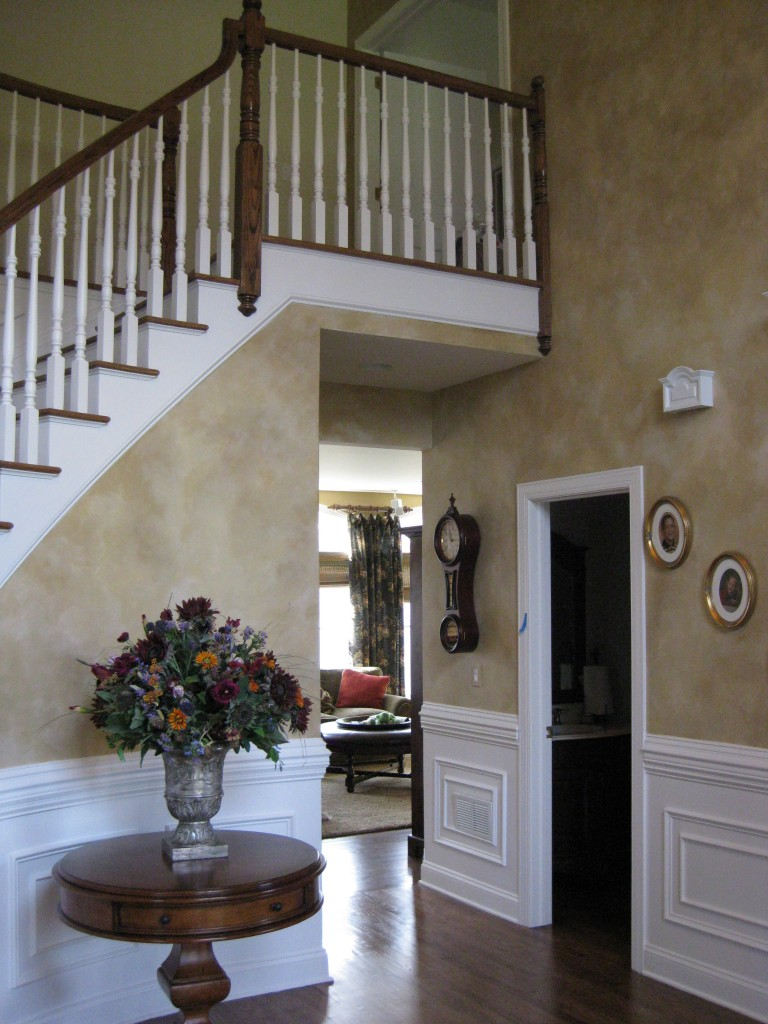 Three-color blended finish painted in two-story foyer.