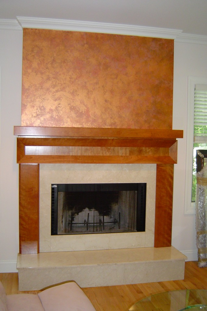 Faux copper leaf painted above fireplace mantel.