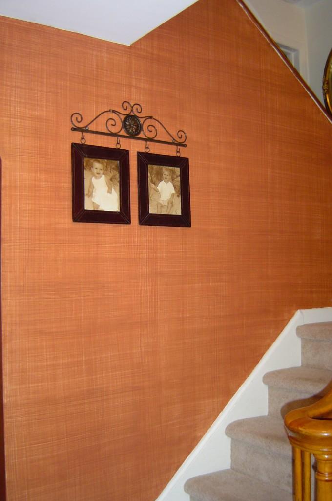 Burnt sienna linen-weave glaze in a foyer.