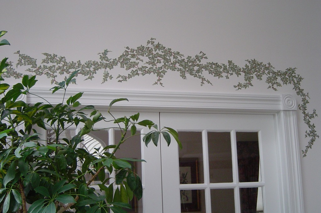 Decorative ivy painted to accent a doorway.