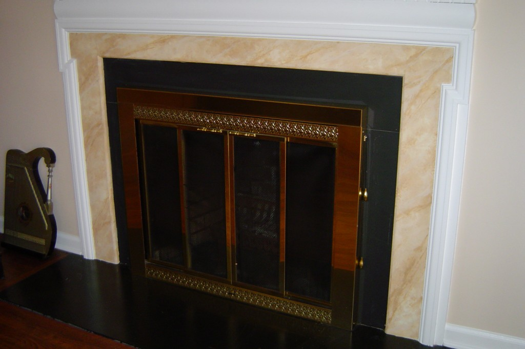 Mantle inset is painted to replicate marble.
