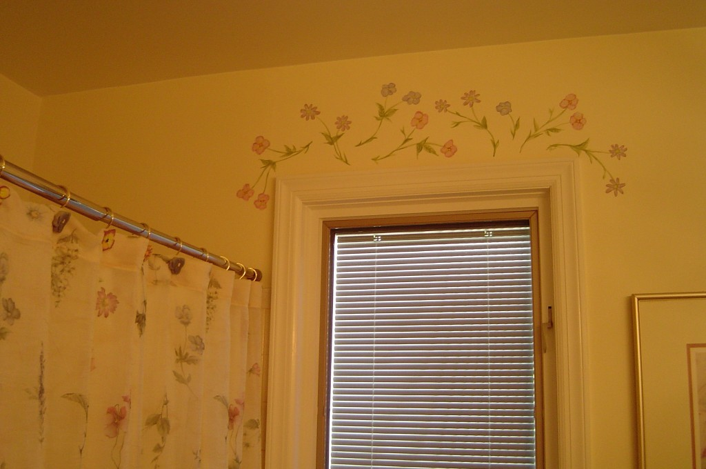 Decorative floral accents painted above the window to coordinate with Bathroom accessories.