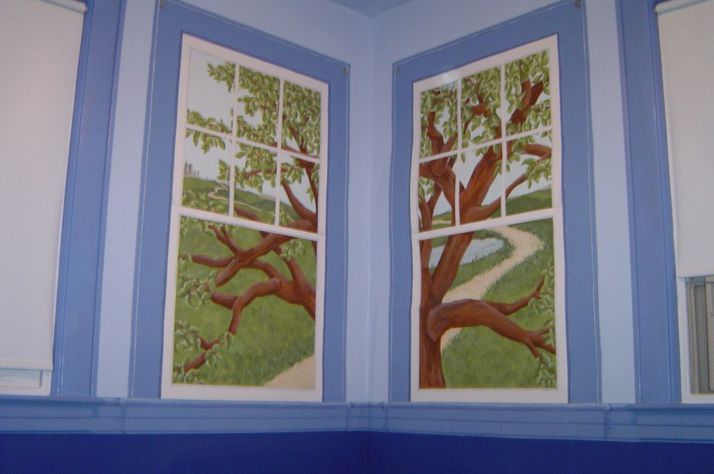 Whimsical outdoor scene painted within trompe-l'oeil window frames that replicate the actual adjacent windows.