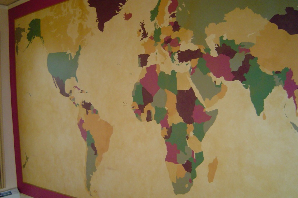 World Map mural with sepia glaze painted on one wall of Home office.