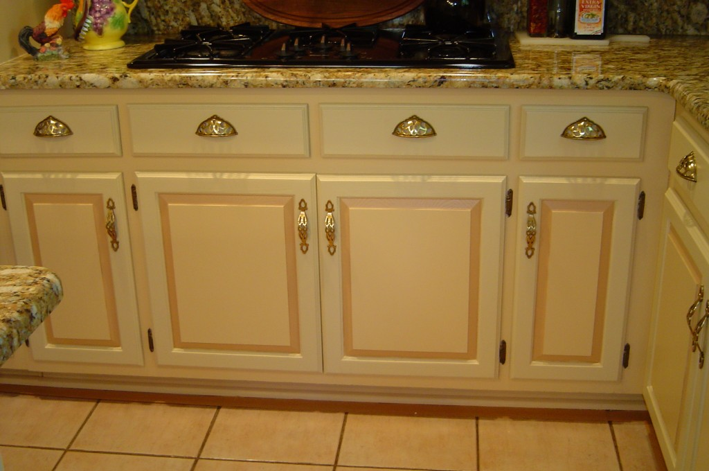 Kitchen cabinets painted in three-color motif with glaze overall.