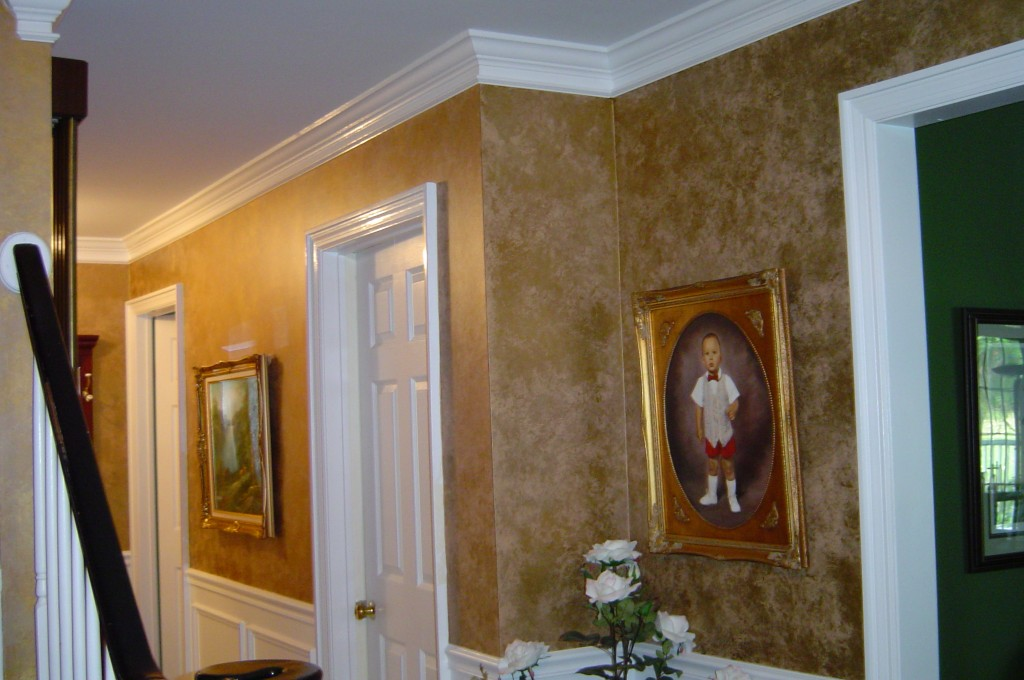Metallic gold glaze finish painted above wainscot in foyer.