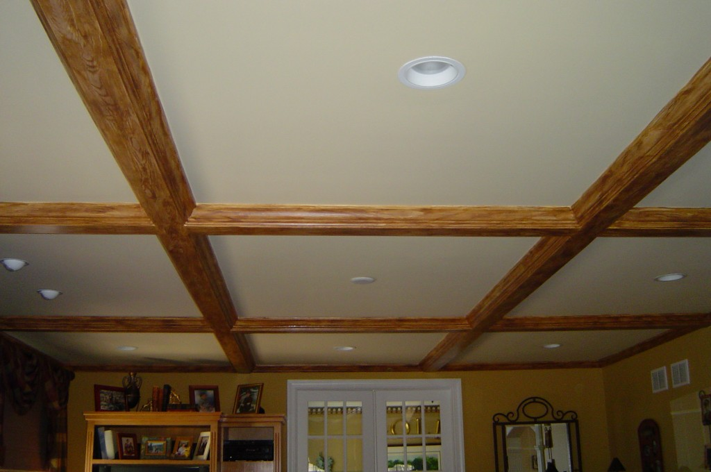 Ceiling beams painted with faux woodgrain.