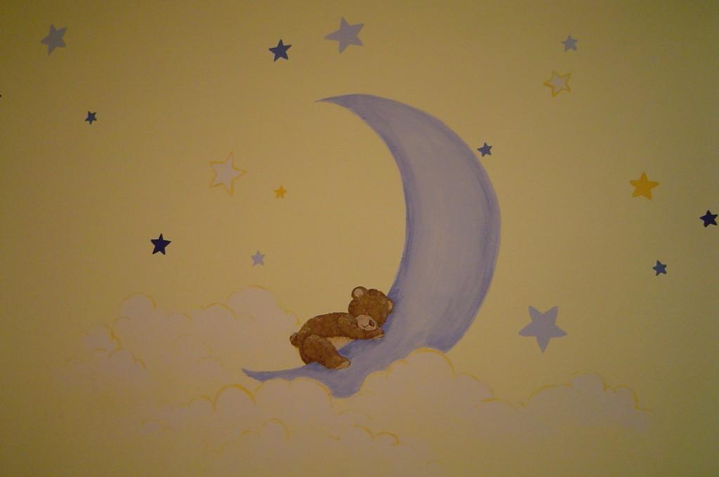 Nursery painted with bears, moon and stars.