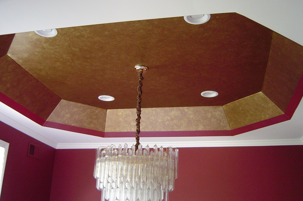 "Painted gold ""leaf"" finish within tray ceiling in Dining Room."