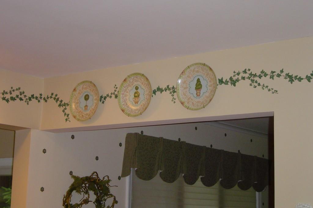 Decorative vine border painted around Kitchen walls.