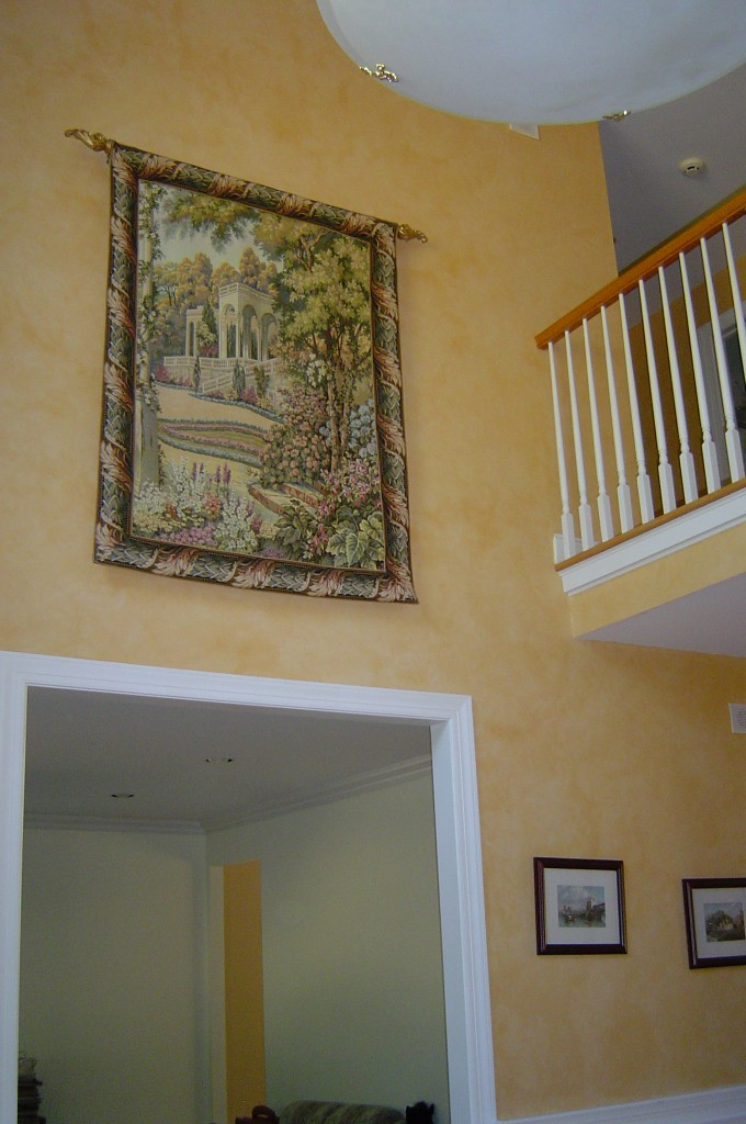 Two-story foyer painted in parchment glaze finish.