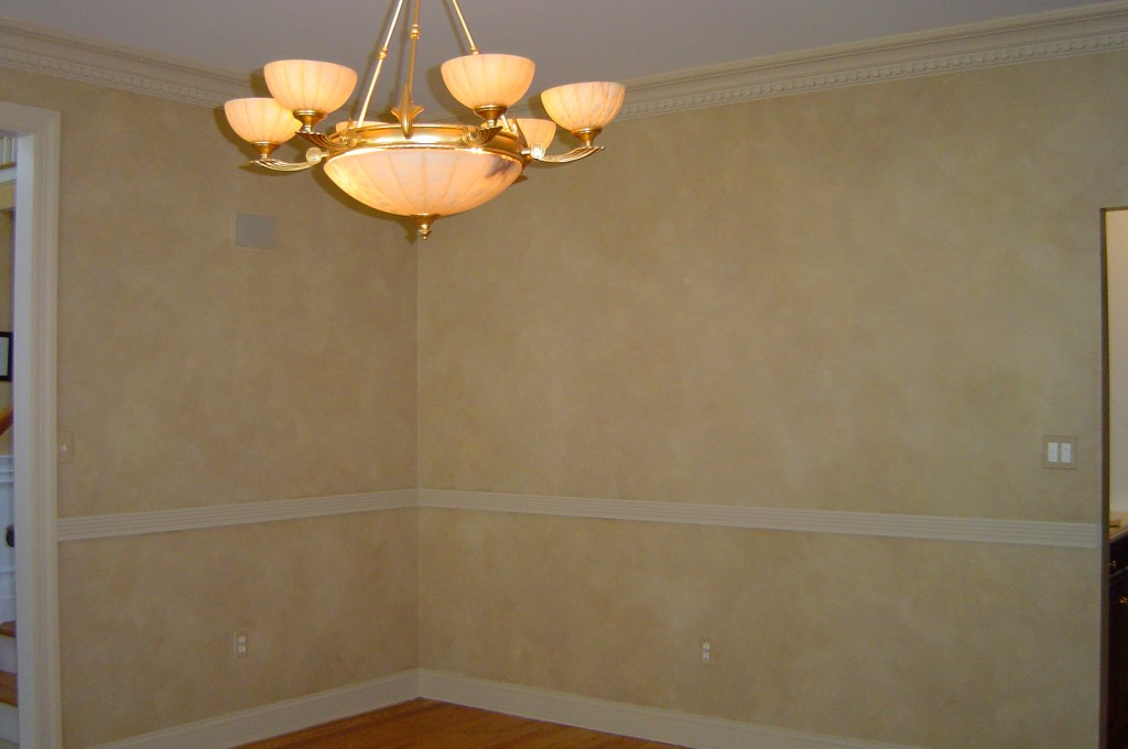 Living Room walls painted with three-color blended paint finish.