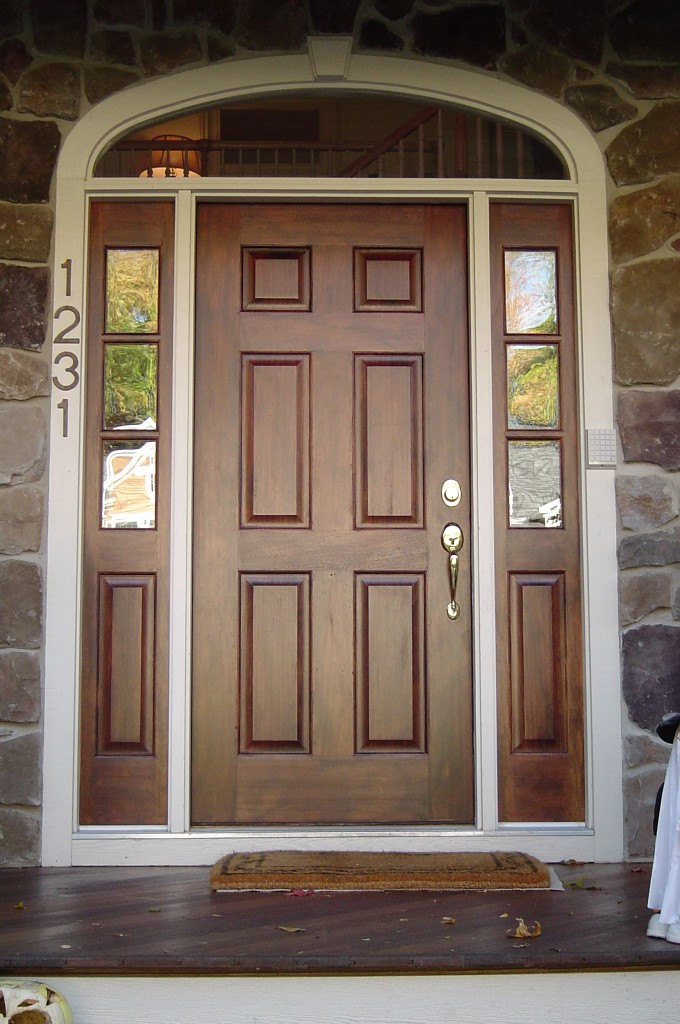 """Entry door and sidelights """"antiqued"""" with chestnut glaze."""