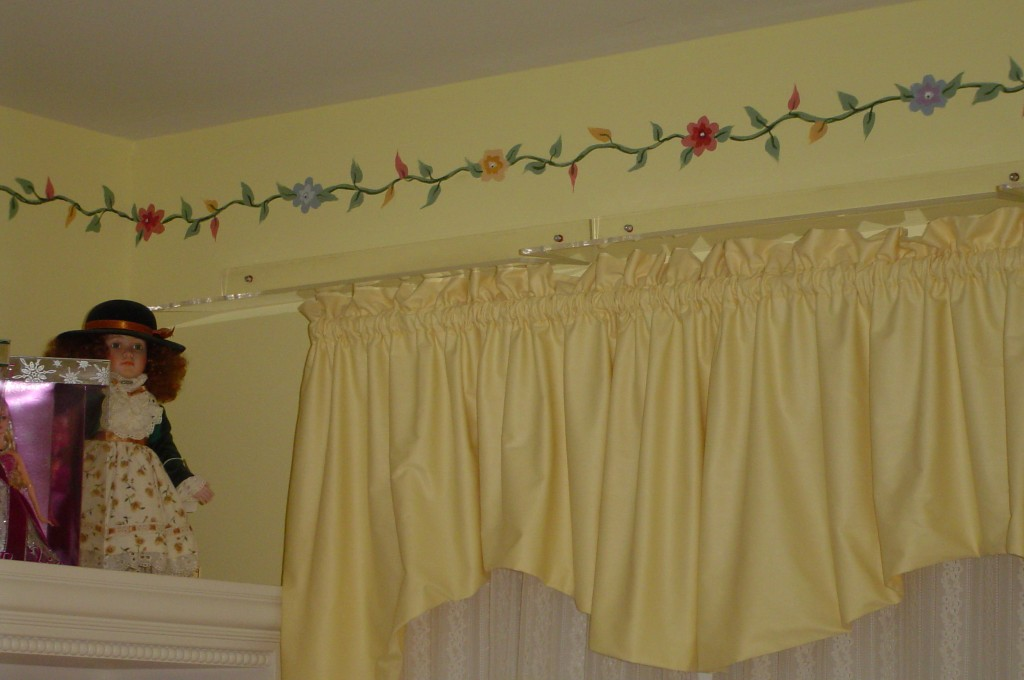 Decorative floral border painted in girl's bedroom to complement carpet design.