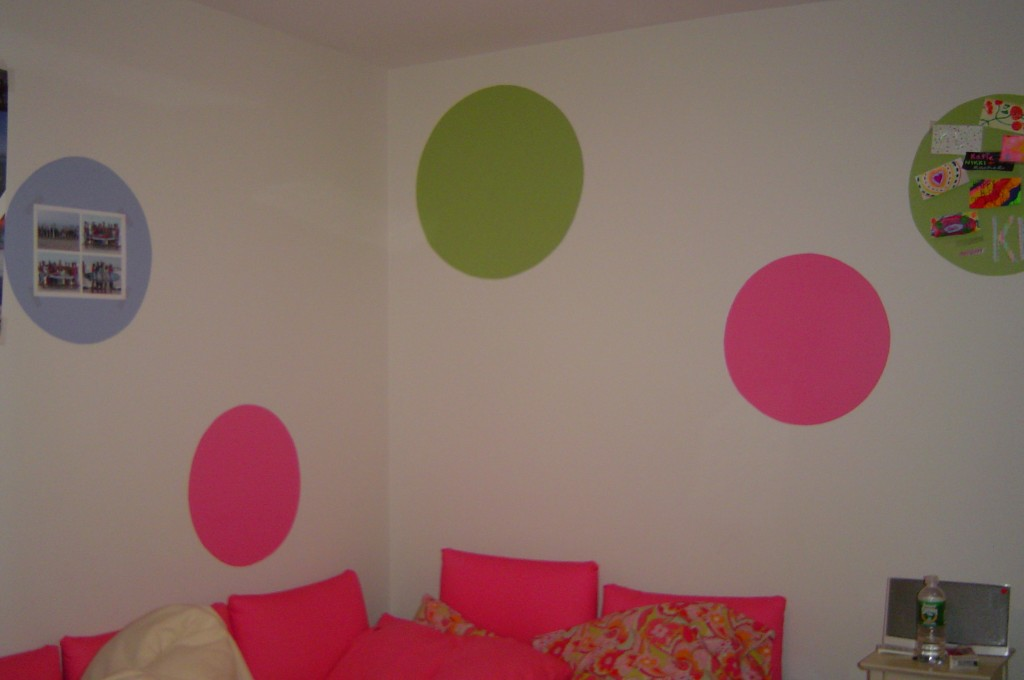 Large brightly colored circles painted in teen's bedroom.