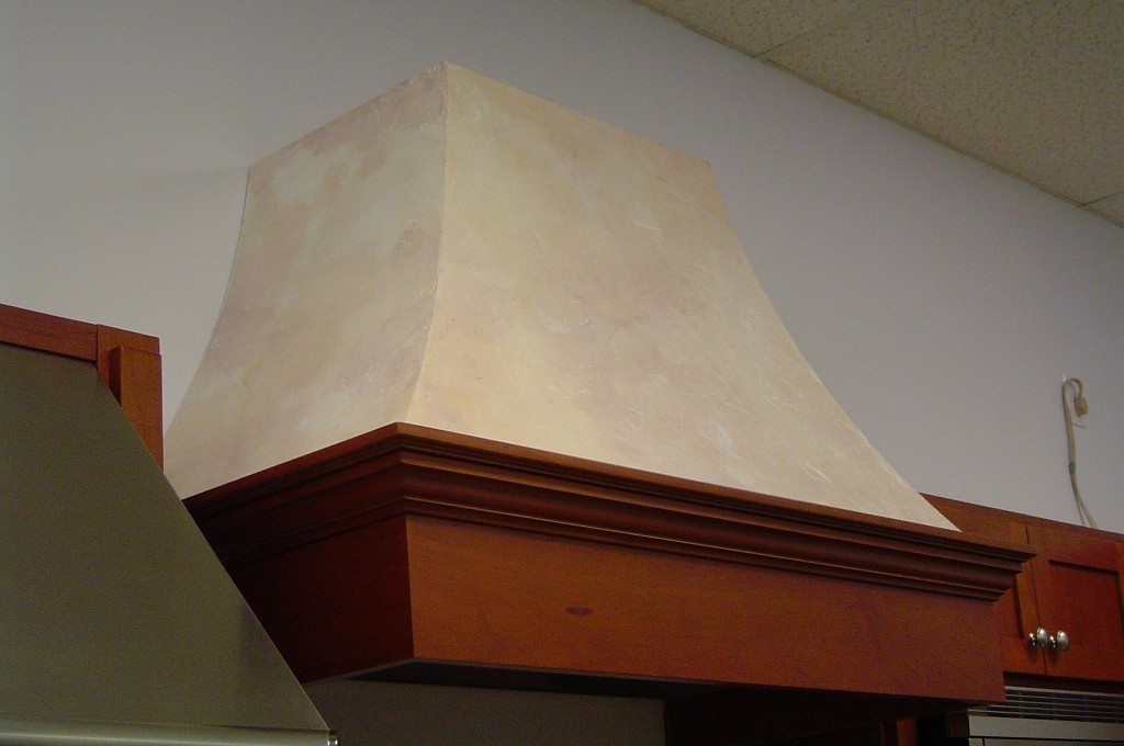 Stucco finish applied to kitchen range hood, and painted with stone colorwash finish.