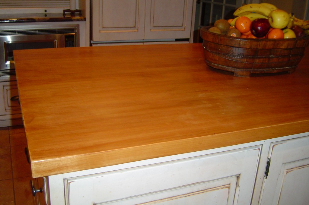Butcher-block kitchen island re-stained and finished.