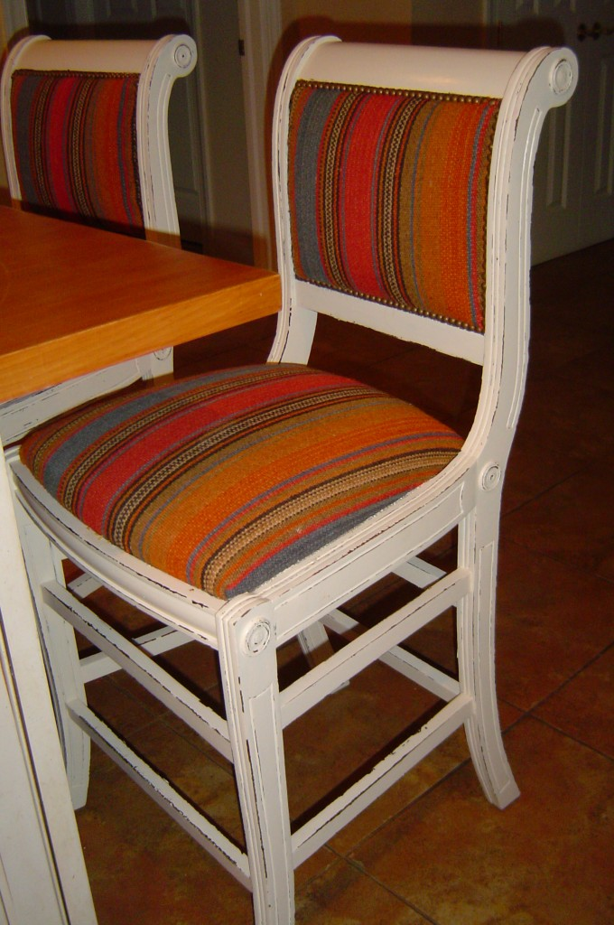 Set of Kitchen bar chairs painted and distressed to reveal base color at edges
