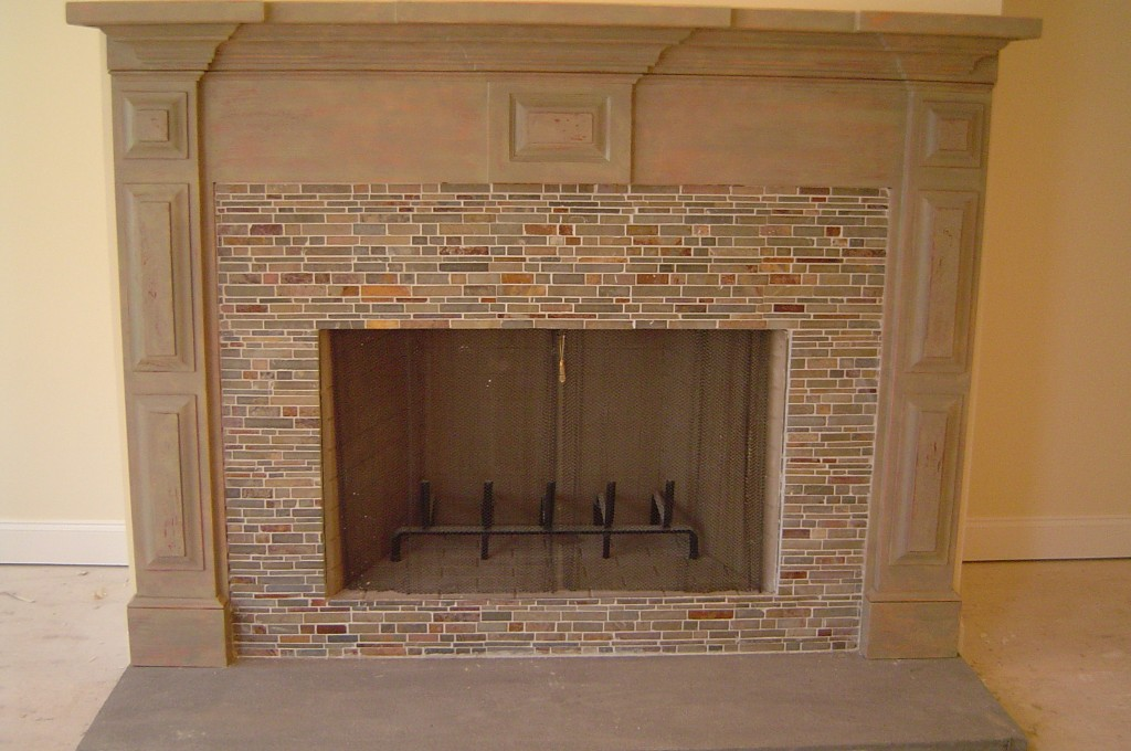 Newly constructed fireplace mantle in multi-layer distressed finish.