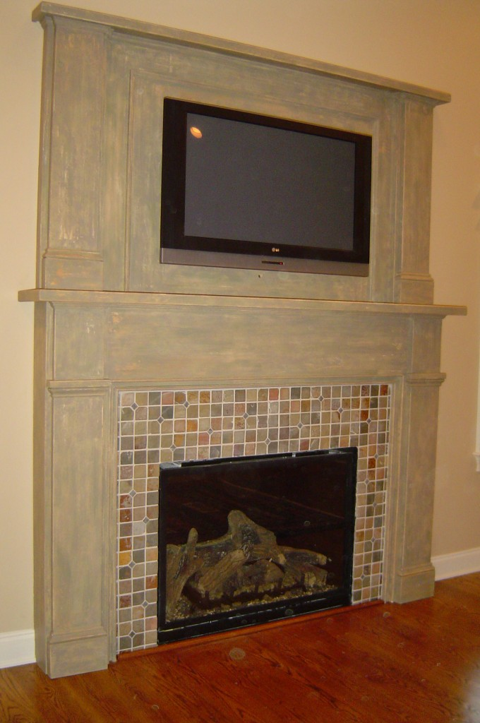 newly constructed fireplace mantle painted with a multi-layer distressed finish.
