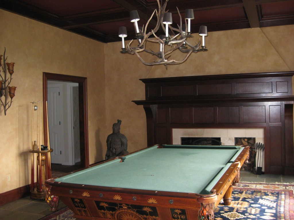 Glaze paint treatment over textured plaster wall finish in Billiards Room.