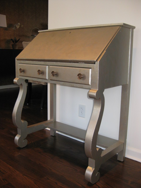 Antique writing desk painted in warm silver finish.