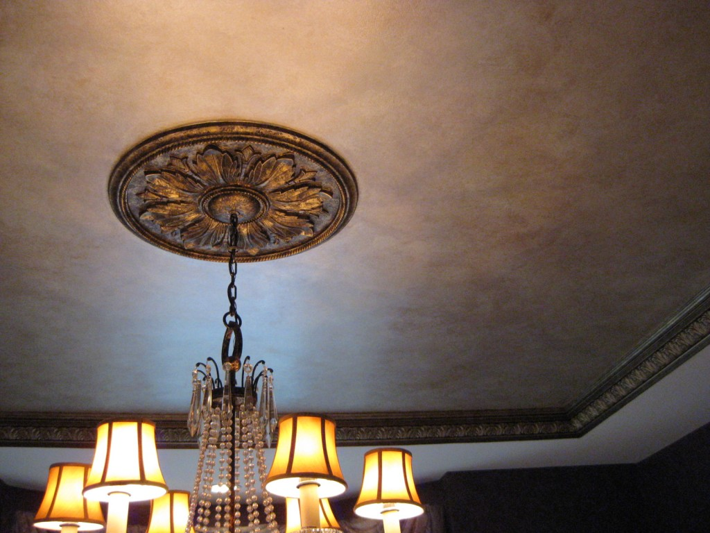 Warm gold/silver paint treatment on the Dining Room tray ceiling, and antique bronze finish on crown molding and chandelier plaque.
