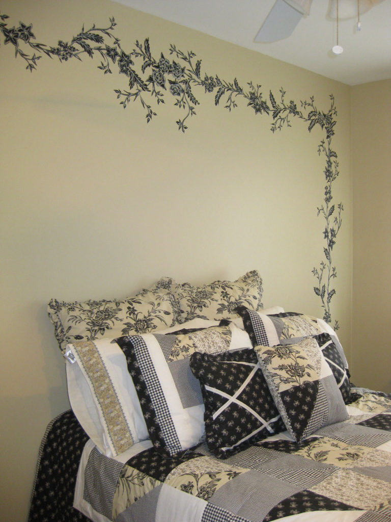 Hand-painted decorative detail painted as a border to complement the bedding.