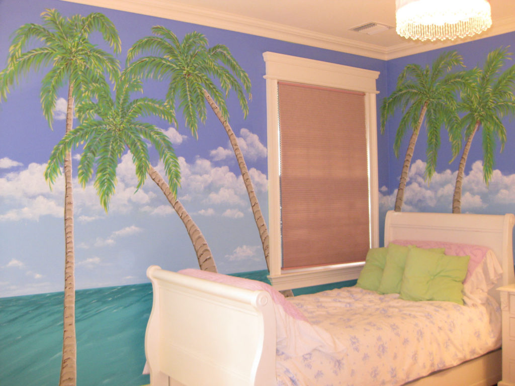 Ocean view with palm trees painted in teen's bedroom.