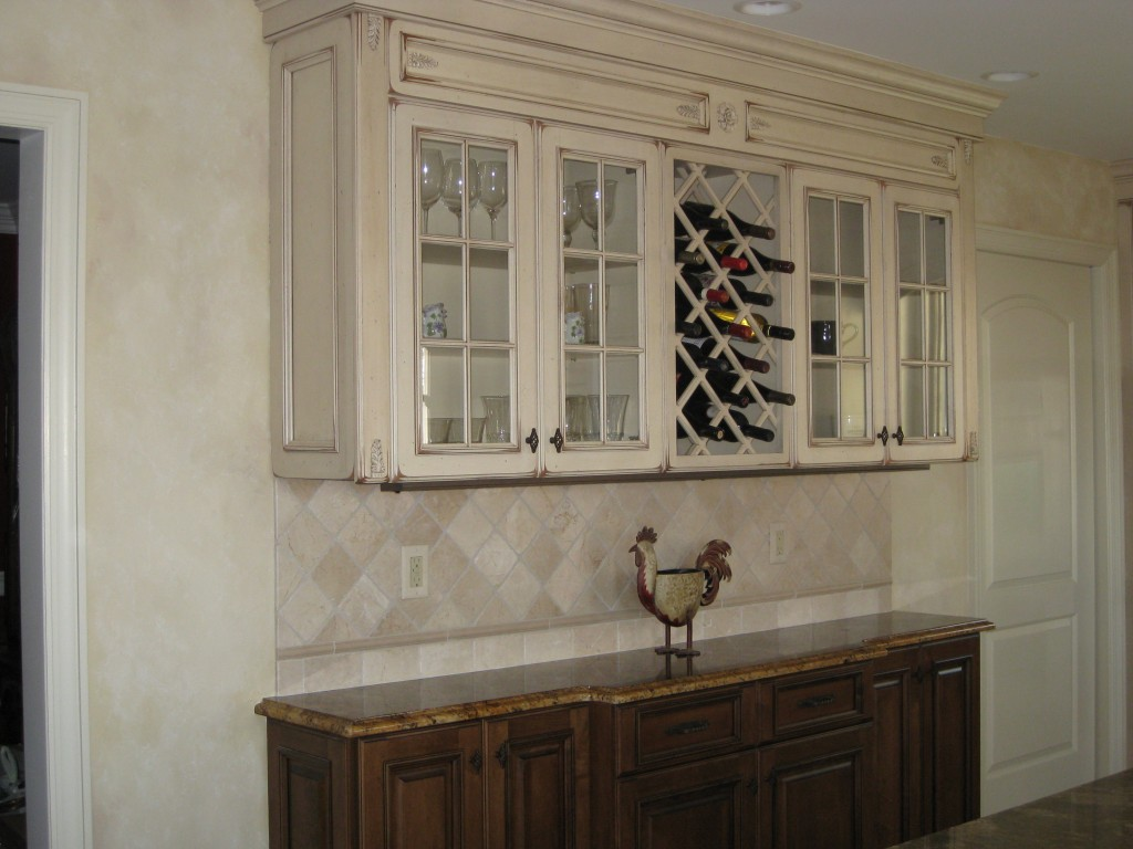 Kitchen walls treated in textured plaster and painted to coordinate with cabinetry.