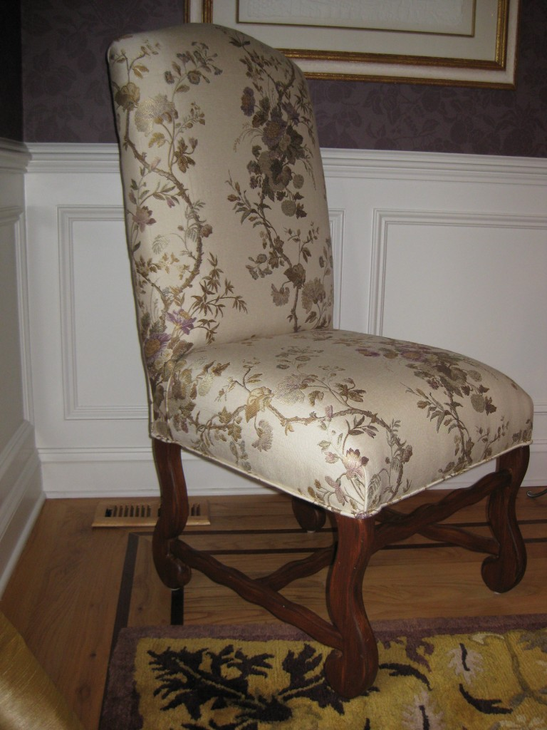 Blond wood dining chairs refinished to replicate mahogany.