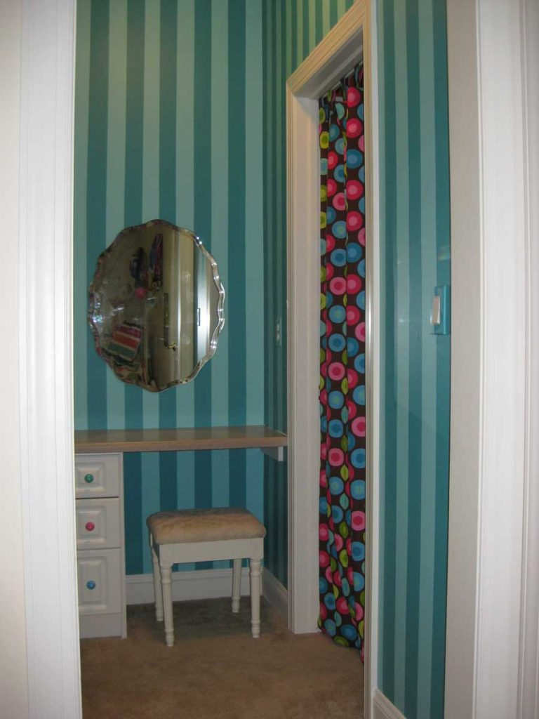 Bright shadow stripe painted in girl's bedroom hallway.