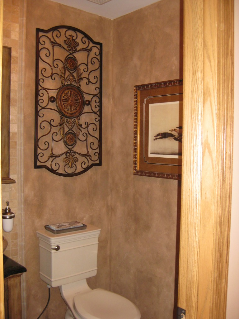 Heavily textured plaster finish and color-wash in Powder Room.