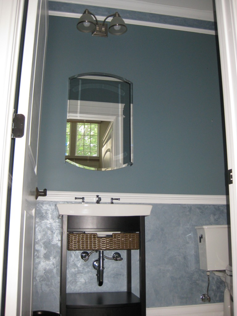 "Blue ""Shimmerstone"" plaster applied below chair rail and within crown in Powder Room"