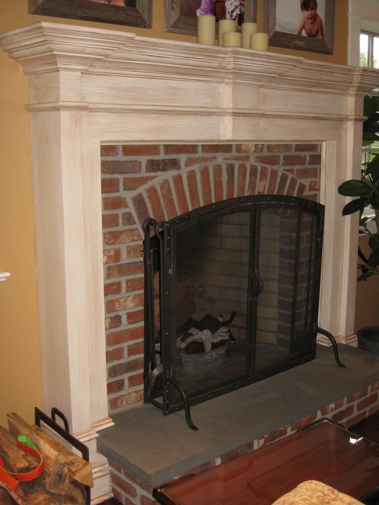 Antique glaze finish painted on fireplace surround.