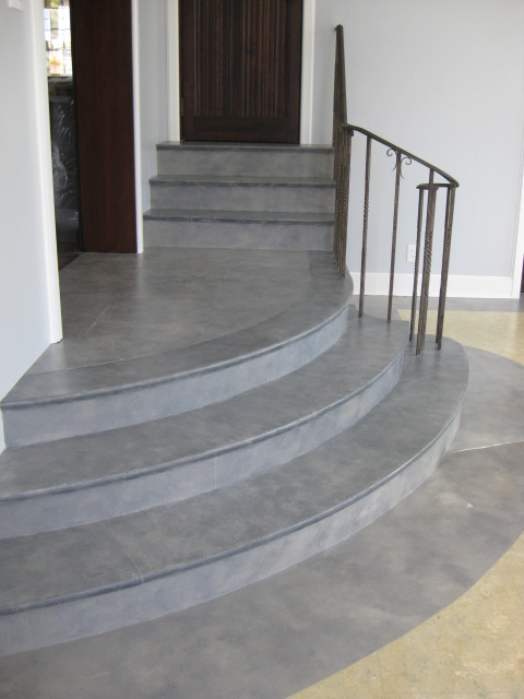 Slate floor finish painted on stairs and perimeter of floor in music room.