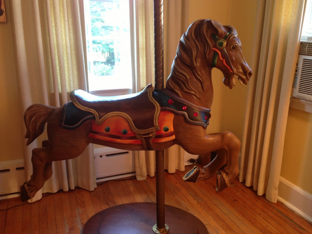 Restoration and repainting of antique carousel horse