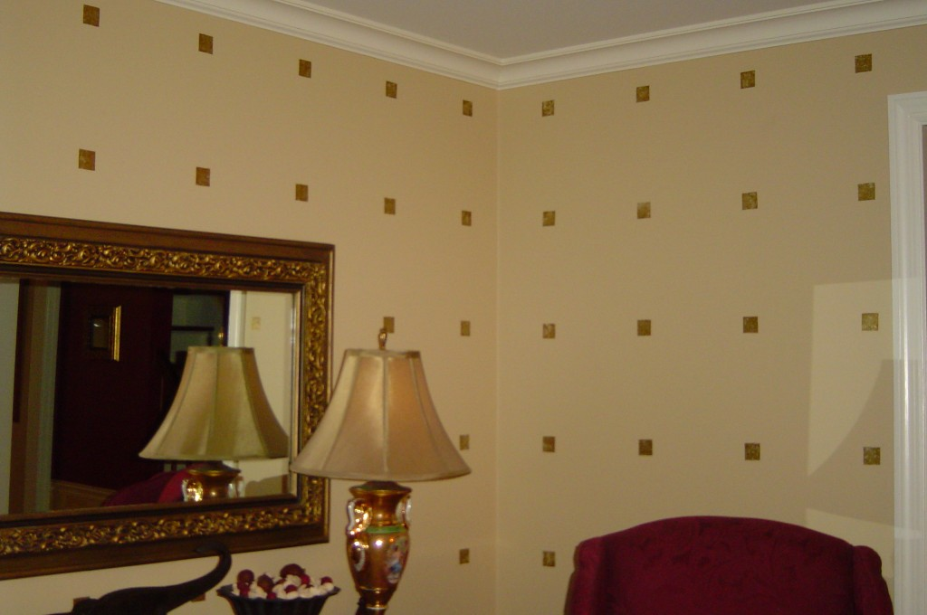 Gold leaf squares in graphic pattern on Living Room walls.