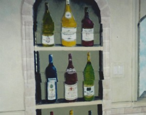 The wine cabinet disguises an access panel on the wall.