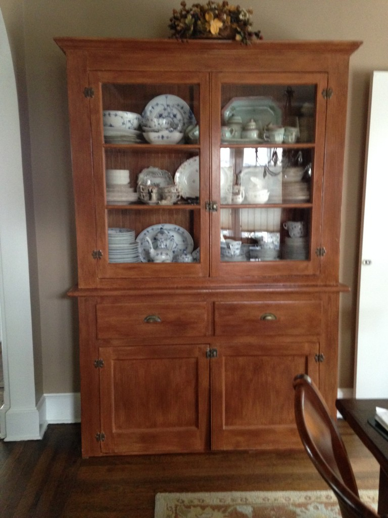 Antique pine pantry cabinet painted with faux cherry wood finish.