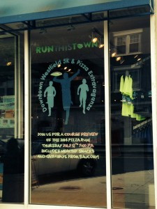 Storefront window design for run event.