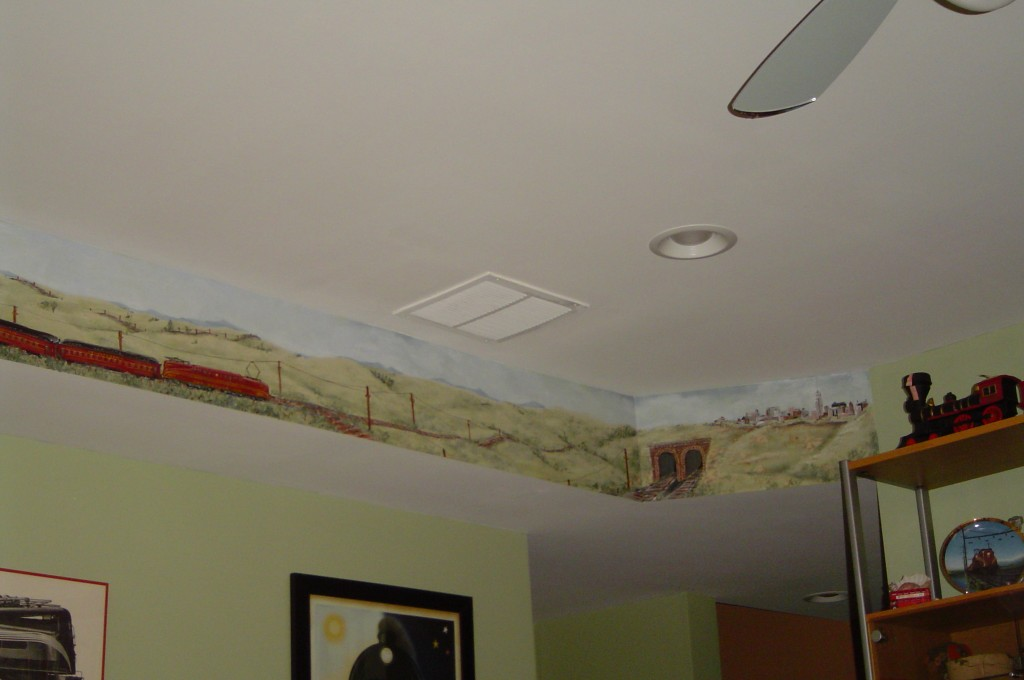 Detail from vintage train mural along soffit in Family Room.