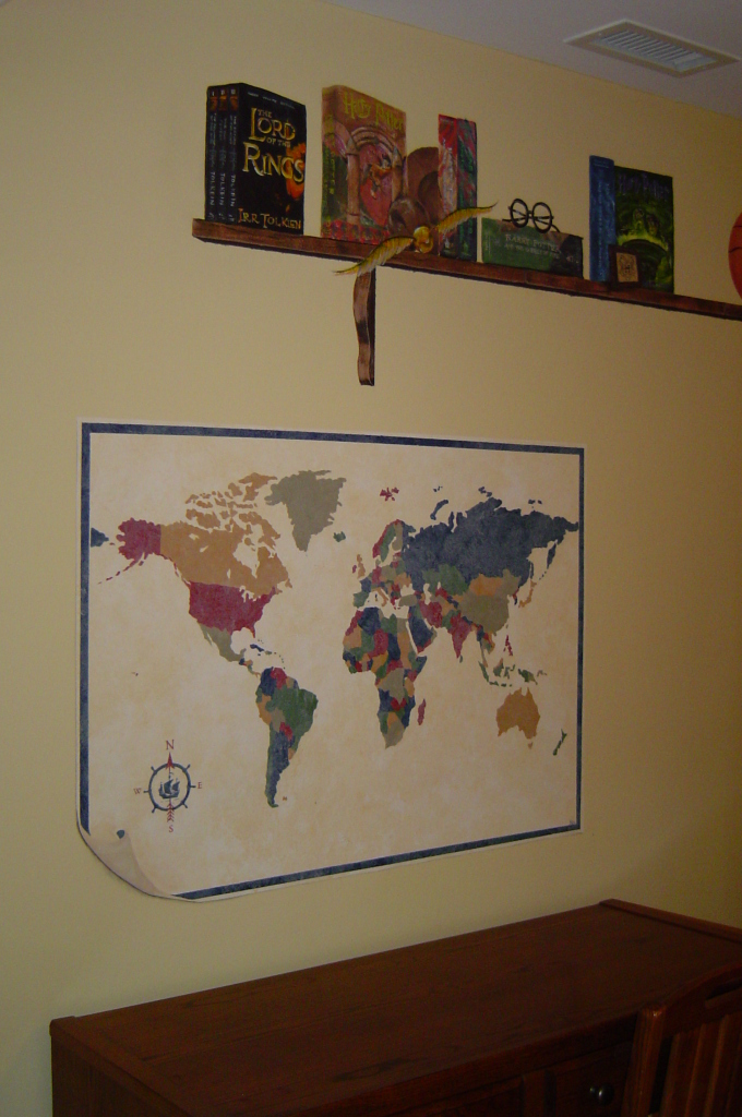 World map and painted shelf above.