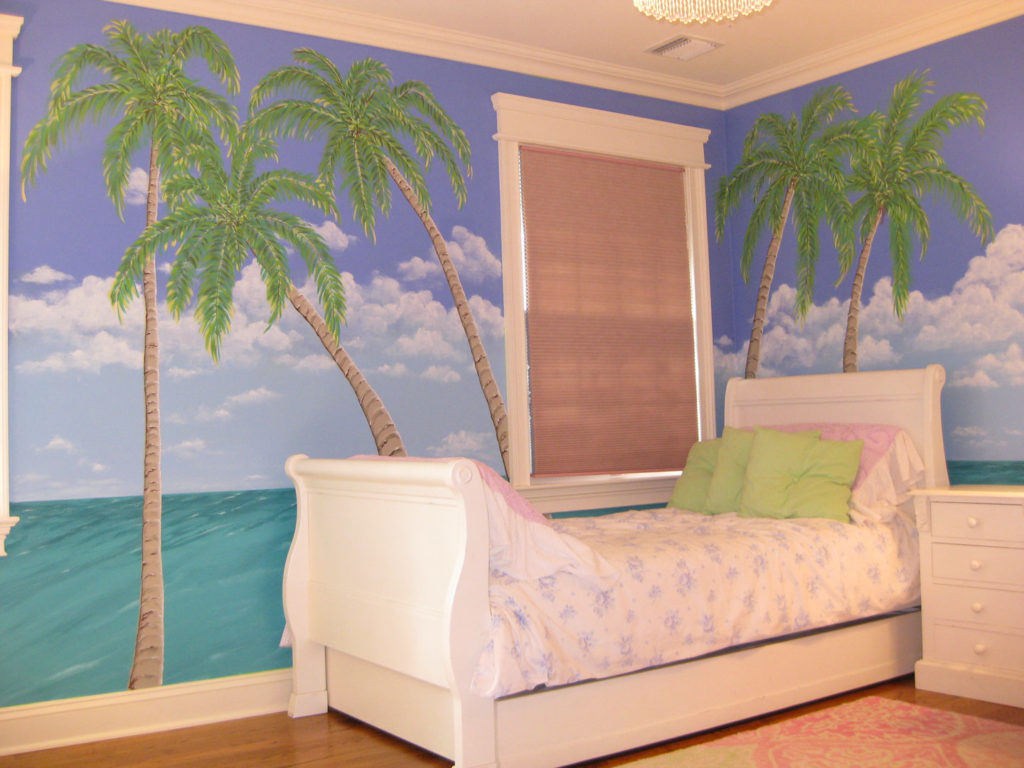 Mural with ocean and palm trees.