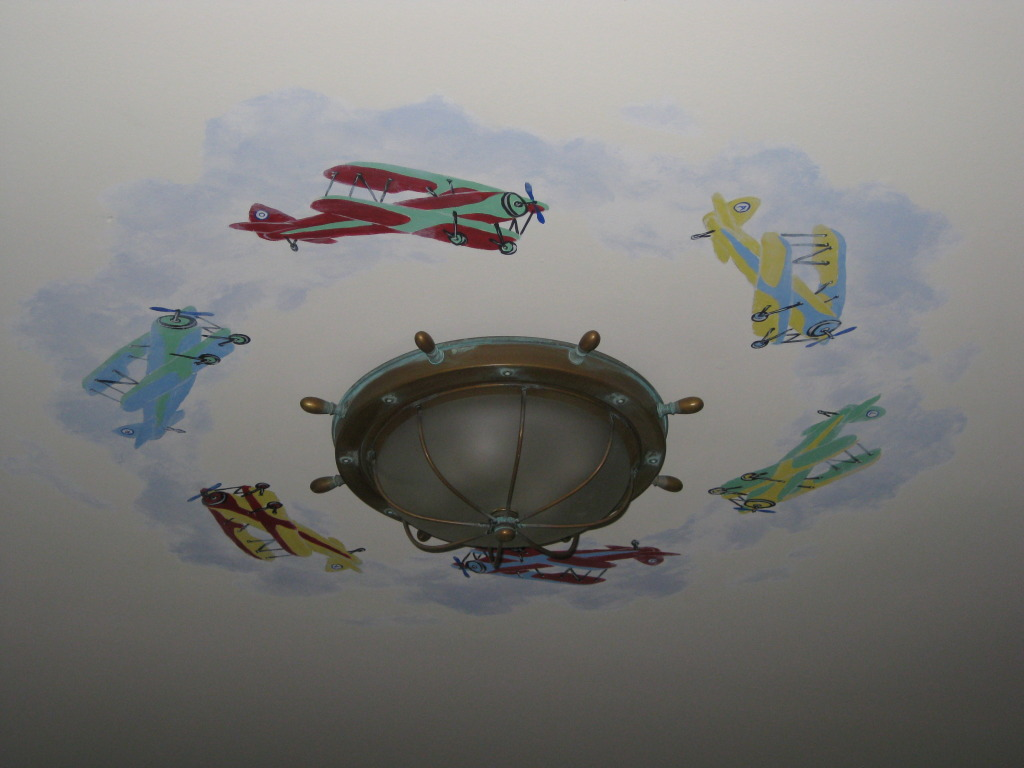 Bi-planes painted around ceiling light fixture.