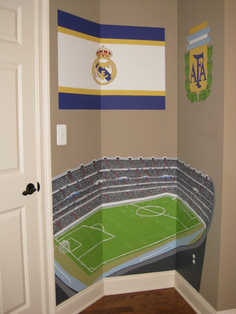 Soccer stadium painted in bedroom alcove.